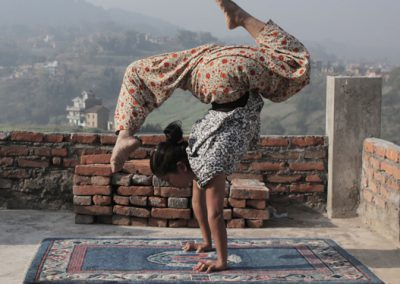 girl-balancing-on-roof square